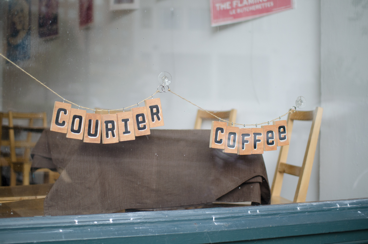 Courier Coffee sign